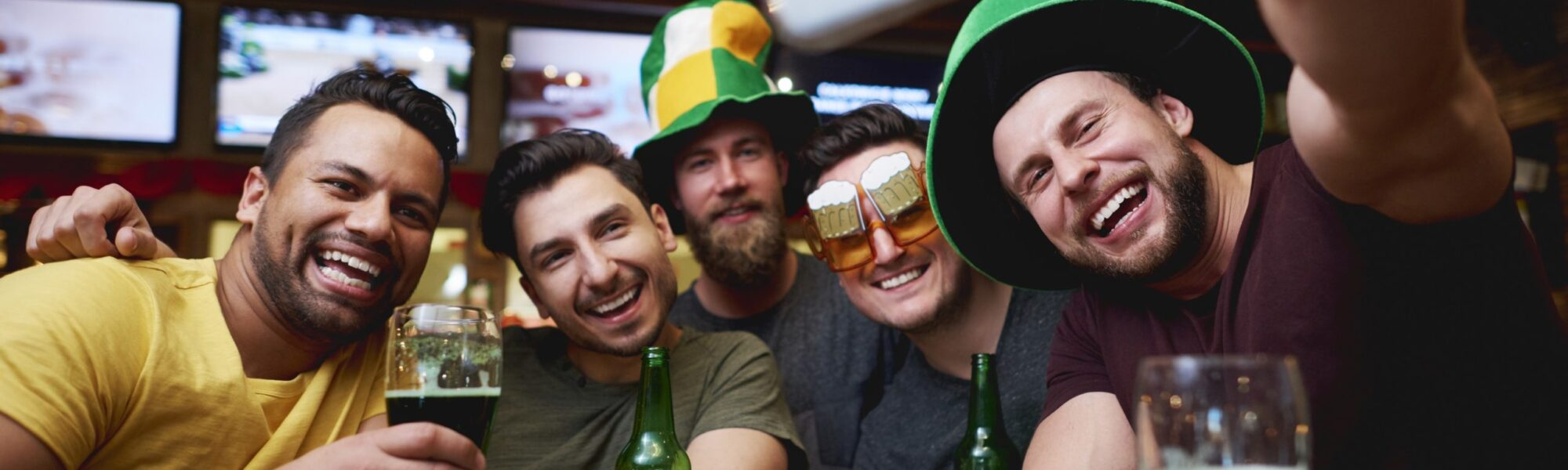 Friends celebrating St. Patrick's Day - gpointstudio