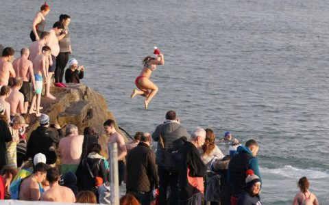 Irish people swimming at Christmas at Forty Foot - stecollinspic@gmail.com